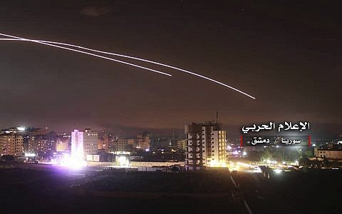 Illustrative: Missiles rise into the sky as Israel hits an air defense position and other military bases, in Damascus, Syria, May 10, 2018. (Syrian Central Military Media, via AP)