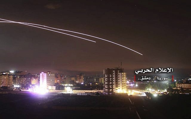 Illustrative: Missiles rise into the sky as Israeli missiles hit air defense position and other military bases, in Damascus, Syria, May 10, 2018. (Syrian Central Military Media, via AP)