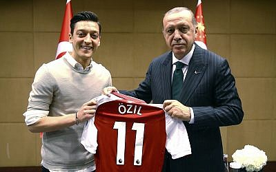 "In this photo taken on Sunday, May 13, 2018, Turkey's President Recep Tayyip Erdogan, right, poses for a photo with Turkish-German Arsenal soccer player Mesut Ozil in London. Erdogan started a three-day visit to Britain on Sunday by praising the country as ""an ally and a strategic partner, but also a real friend."" (Presidential Press Service/Pool via AP)"