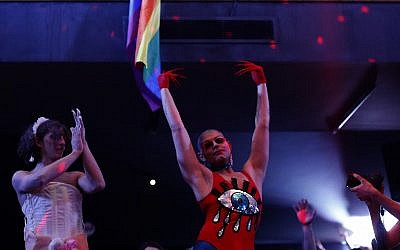 In this illustrative picture taken Sunday, May 13, 2018, Elias, 24, who goes by the stage name of Melanie Coxxx, right, performs during a Sunday drag queen show, called the drag ball, during Beirut Pride week, Lebanon. (AP Photo/Hassan Ammar)