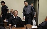 Defendant Ralf Wohlleben, center with white bag, arrives for his trial in the court room in Munich, Germany, June 5, 2018. (AP Photo/Matthias Schrader, Pool)