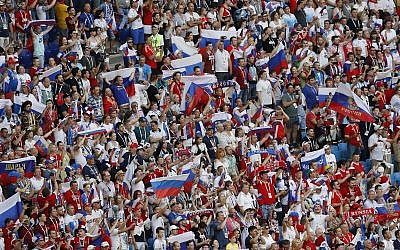 Russia soccer fans cheer for their team ahead the group A match between Uruguay and Russia at the 2018 soccer World Cup at the Samara Arena in Samara, Russia, Monday, June 25, 2018. (AP/Efrem Lukatsky)