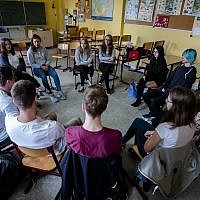 In this June 25, 2018, photo, Laura Schulmann, center right, and Sophie Steiert, center left, listen to questions from students about Jewish daily life in Germany during a lesson as part of a project about religions at the Bohnstedt Gymnasium high school in Luckau, Germany (AP Photo/Markus Schreiber)