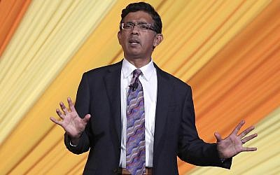 Author and filmmaker Dinesh D'Souza the keynote speaker at the Republican Sunshine Summit addresses the audience, June 29, 2018, in Kissimmee, Florida (AP Photo/John Raoux)