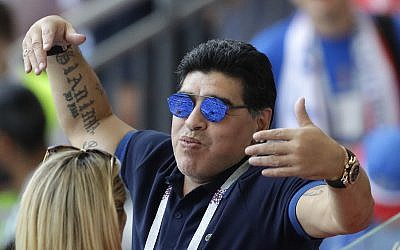 Argentinian soccer legend Diego Armando Maradona waves to visitors during the round of 16 match between France and Argentina, at the 2018 soccer World Cup at the Kazan Arena in Kazan, Russia, June 30, 2018. (AP Photo/ Sergei Grits)