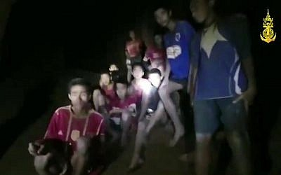 In this grab taken from video provided by the Thai Navy Seal, a view of the boys and their soccer coach in a cave, in Chiang Rai in Thailand, July 2, 2018 (Thai Navy Seal via AP)