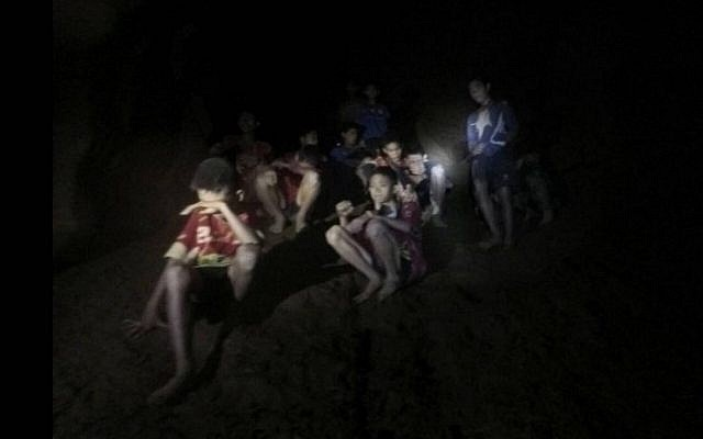 A photo released by Tham Luang Rescue Operation Center, shows the boys and their soccer coach as they were found in a partially flooded cave, in Mae Sai, Chiang Rai, Thailand, July 2, 2018. (Tham Luang Rescue Operation Center via AP)