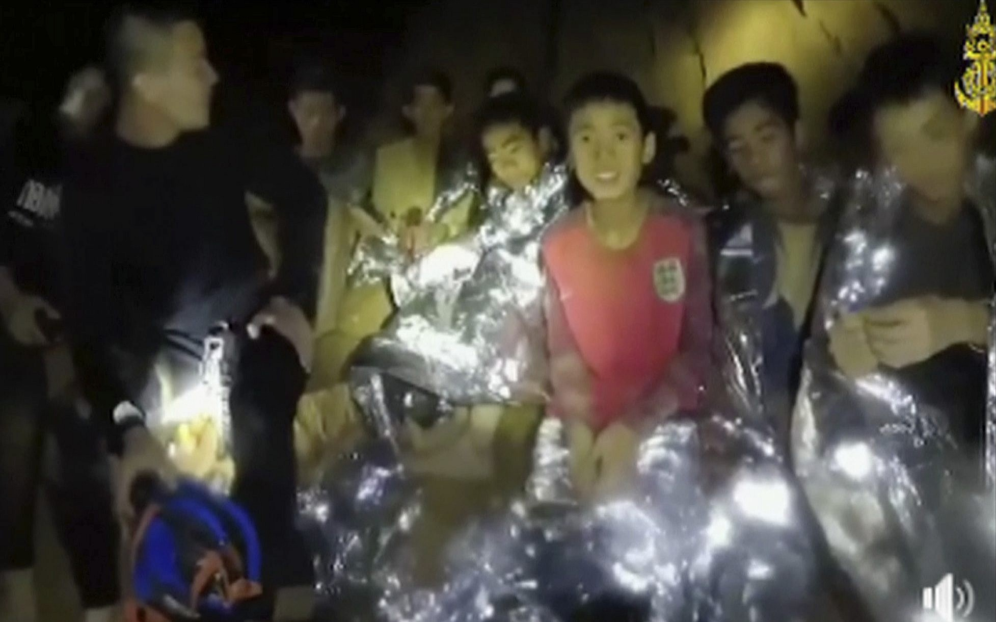 In this July 3, 2018 image, trapped Thai boys are with Navy SEALs inside a cave in northern Thailand (Thai Navy Seal via AP)