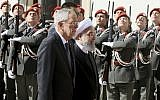 Austrian President Alexander Van Der Bellen, left, and Iranian President Hassan Rouhani attend a military welcome ceremony in Vienna, Austria, Wednesday, July 4, 2018 (AP Photo/Ronald Zak)