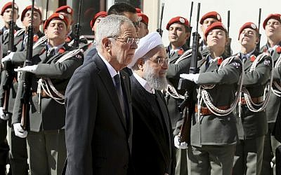 Austrian President Alexander Van Der Bellen, left, and Iranian President Hassan Rouhani attend a military welcome ceremony in Vienna, Austria, Wednesday, July 4, 2018 (AP Photo/Ronald Zak)