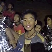 Image taken from video shows Thai children trapped inside a cave in Mae Sai, northern Thailand. (Royal Thai Navy Facebook Page via AP)