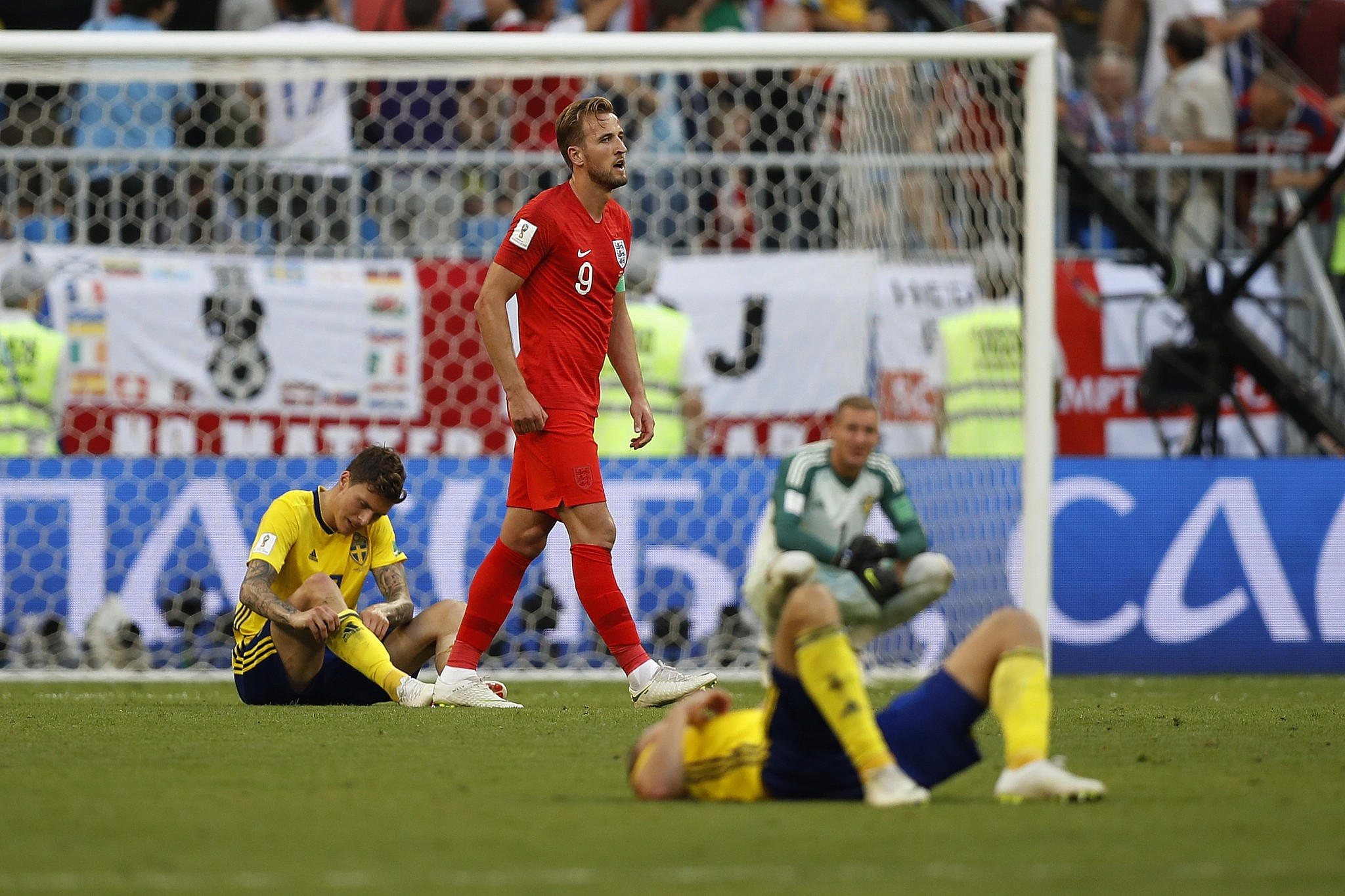England s Harry Kane walks past Sweden s players at the end of the match  after his team 15e0e06af
