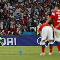 Croatia goalkeeper Danijel Subasic, right, celebrates Ivan Rakitic at the end of the quarterfinal match between Russia and Croatia at the 2018 soccer World Cup in the Fisht Stadium, in Sochi, Russia, July 7, 2018. (AP Photo/Rebecca Blackwell)