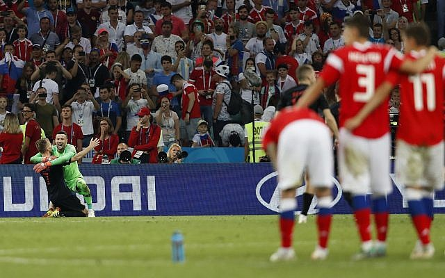 Croatia goalkeeper Danijel Subasic, right, celebrates Ivan Rakitic at the end of the quarterfinal match between Russia and Croatia at the 2018 soccer World Cup in the Fisht Stadium, in Sochi, Russia, July 7, 2018. (AP Photo/Rebecca Blackwell)