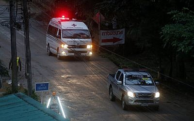 An ambulances leave the cave in northern Thailand hours after efforts were renewed to to rescue the trapped youth soccer players and their coach in northern Thailand, Sunday, July 8, 2018 (AP Photo/Sakchai Lalit)