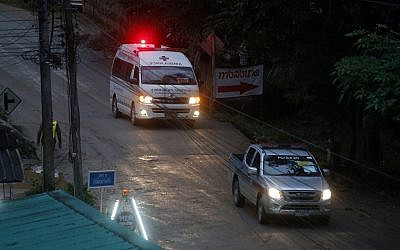 One of two ambulances leave the cave in northern Thailand hours after operation began to rescue the trapped youth soccer players and their coach, in Mae Sai, Chiang Rai province, in northern Thailand, July 8, 2018 (AP Photo/Sakchai Lalit)