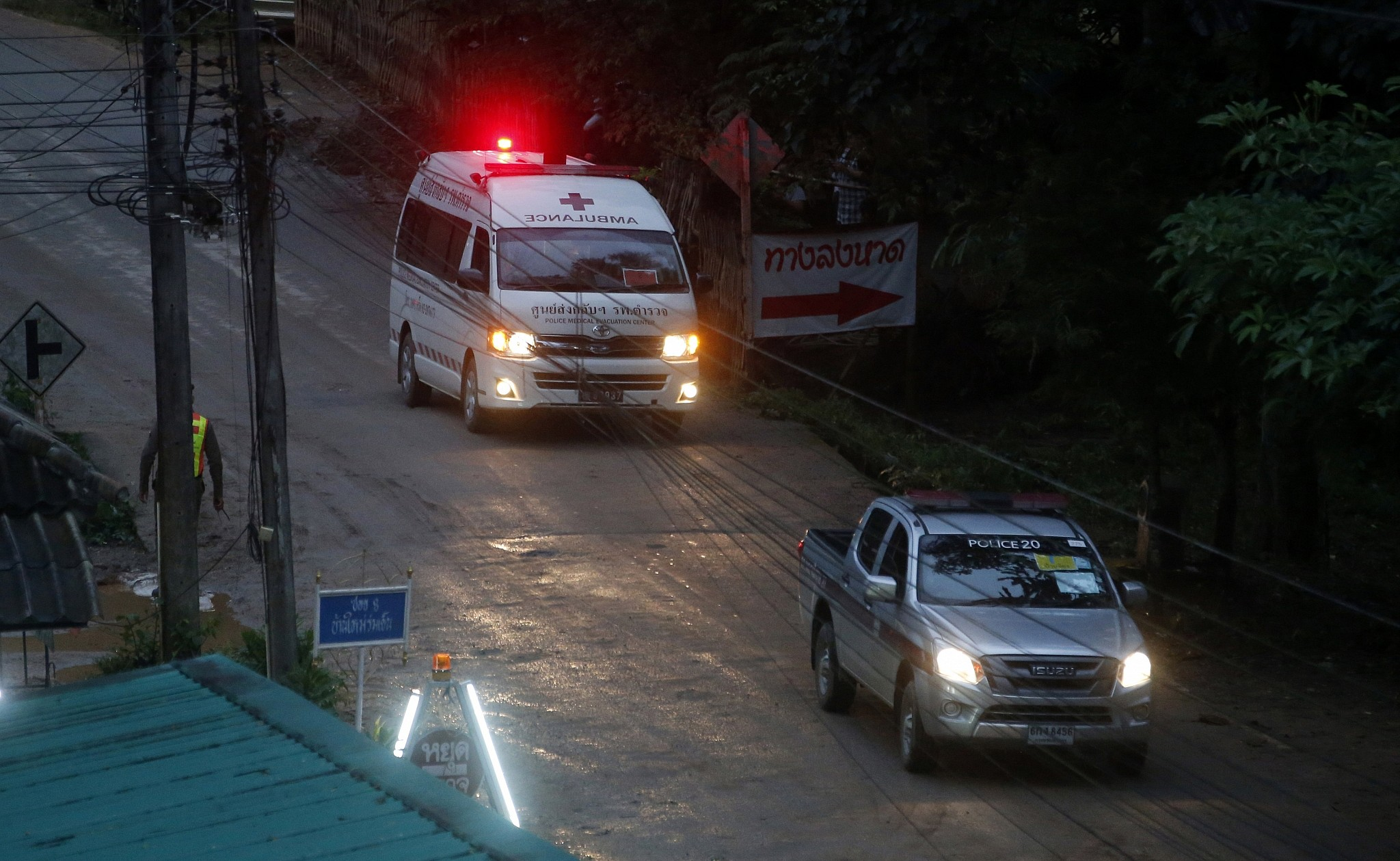 One of two ambulances leave the cave in northern Thailand hours after operation began to rescue the trapped youth soccer players and their coach in Mae Sai Chiang Rai province in northern Thailand