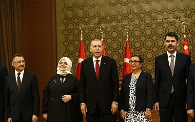 Turkey's President Recep Tayyip Erdogan, center, poses with some members of his newly presented cabinet following a news conference at Presidential Palace, in Ankara, Turkey, Monday, July 9, 2018 (AP Photo/Burhan Ozbilici)