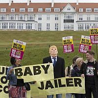 Activists from Stand Up to Racism Scotland (SUTR) stage a protest at the Trump Turnberry resort ahead of the US president's arrival in the UK, in South Ayrshire, Scotland, July 11, 2018. (David Cheskin/PA via AP)