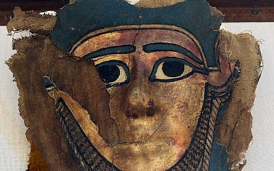 A recently discovered gilded mummy mask is displayed after it was found in a disturbed context of the hall way of a burial chamber dating back some 2,500 years at an ancient necropolis near Egypt's famed pyramids in Saqqara, Giza, Saturday, July 14, 2018. (AP/Amr Nabil)
