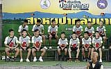 Members of the rescued soccer team and their coach sit during a press conference discussing their ordeal in the cave in Chiang Rai, northern Thailand, July 18, 2018 (AP Photo/Vincent Thian)