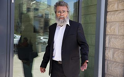 """Rabbi Dov Haiyun arrives for a prescheduled event at the President's Residence in Jerusalem, July 19, 2018. Israeli police briefly detained Haiyun in the city of Haifa early Thursday morning on charges of performing """"illegal"""" Jewish weddings without authorization of the country's chief rabbinate. (AP Photo/Ariel Schalit)"""