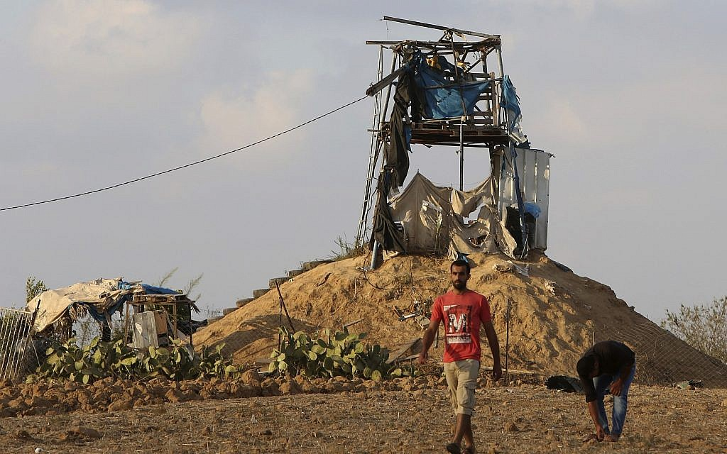 Palestinians inspect a military observation post that was hit by an Israeli tank shell east of Khan Younis, southern Gaza Strip, Friday, July 20, 2018 (AP Photo/Adel Hana)