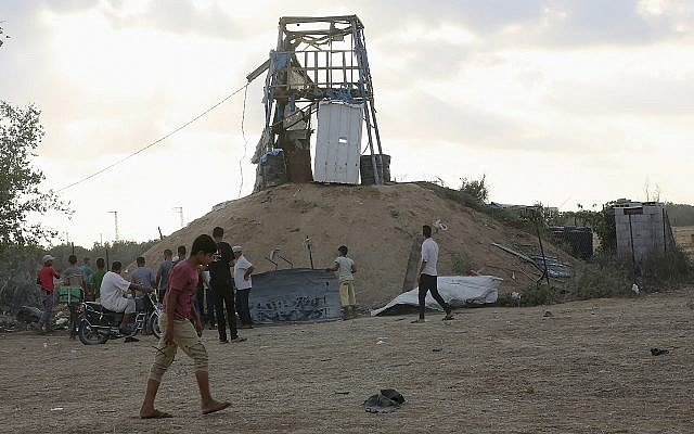 Palestinians inspect a military observation post that was hit by an Israeli tank shell east of Khan Younis, southern Gaza Strip, July 20, 2018 (AP Photo/Adel Hana)