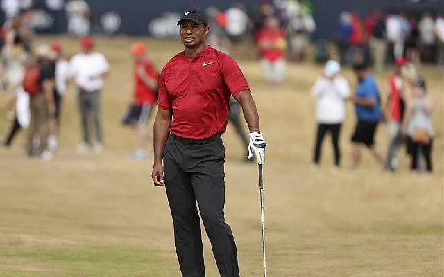 Tiger Woods of the US looks along the 1st fairway during the final round of the British Open Golf Championship in Carnoustie, Scotland, July 22, 2018. (AP Photo/Peter Morrison)