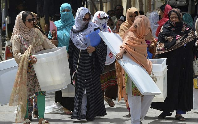 Pakistani election workers collect ballot boxes and polling material from a distribution center in Quetta, Pakistan, July 24, 2018 (AP Photo/Arshad Butt)