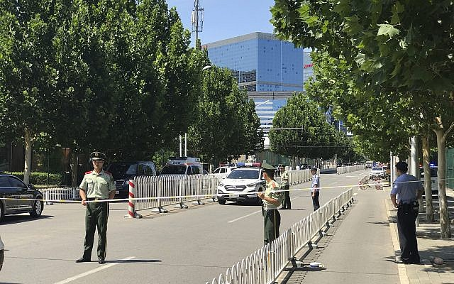 Paramilitary policemen seal off the road leading to the US Embassy in Beijing following a fire or possible explosion outside the complex, July 26, 2018.(Andy Wong/AP)