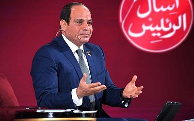 In this photo provided by Egypt's state news agency MENA, Egyptian President Abdel-Fattah el-Sissi speaks during a youth conference in Cairo, Egypt, July 29, 2018. (MENA via AP)