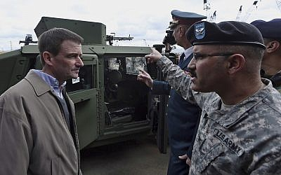 Then US Ambassador to Lebanon David Hale, left, speaks with a US Army soldier during a handover ceremony of US weapons to the Lebanese army at Beirut's port in Lebanon on Sunday, Feb. 8, 2015. (AP Photo/Bilal Hussein)