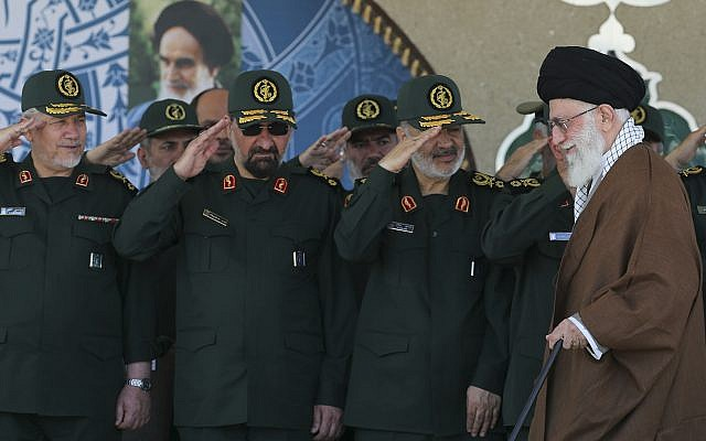 Supreme Leader Ayatollah Ali Khamenei, right, arrives at a graduation ceremony of the Revolutionary Guard's officers, while deputy commander of the Revolutionary Guard, Hossein Salami, second right, former commanders of the Revolutionary Guard Mohsen Rezaei, second left, and Yahya Rahim Safavi salute him, on May 20, 2015,  in Tehran, Iran. (Official website of the Office of the Iranian Supreme Leader via AP)