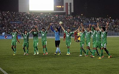 Iraq's national football team celebrates after an international friendly soccer match between Iraq and Syria in Baghdad,, March 26, 2013.  (AP Photo/ Khalid Mohammed/File)
