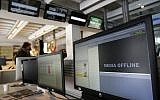 Illustrative image of 'offline' computer screens. (AP Photo/Christophe Ena)