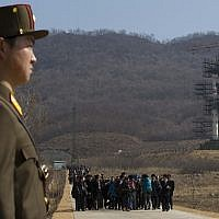 File: In this Sunday, April 8, 2012 file photo, a crowd of media gather around a North Korean official on a road in front of North Korea's Unha-3 rocket, slated for liftoff between April 12-16, stands at Sohae Satellite Station in Tongchang-ri, North Korea (AP Photo/David Guttenfelder, File)