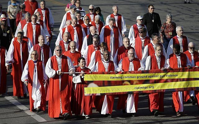 Illustrative: Episcopal Bishops lead a march to urge people of faith to seek common ground to curtail gun violence, during the Episcopal General Convention Sunday, June 28, 2015, in Salt Lake City.  (AP Photo/Rick Bowmer)