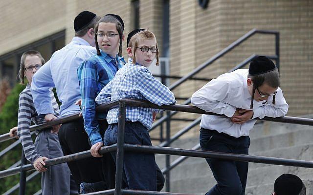 Illustrative: Boys stand outside a school on Tuesday, July 1, 2014, in Kiryas Joel, N.Y.(AP Photo/Mike Groll)