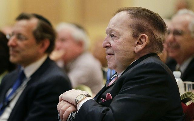 Sheldon Adelson listens as New Jersey Gov. Chris Christie speaks during a Republican Jewish Coalition event, March 29, 2014, in Las Vegas. (AP Photo/Julie Jacobson)