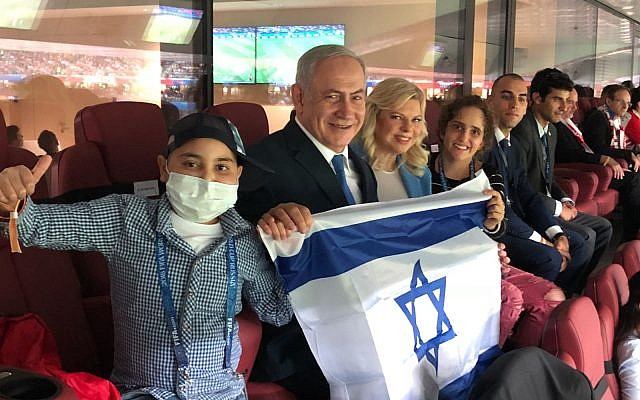 Prime Minister Benjamin Netanyahu and his wife Sara, attending the World Cup semifinal match in Moscow on July 11, 2018, along with Mika Lipsker (18) and Alon Eizarayev (13), who are fighting cancer. (Courtesy)