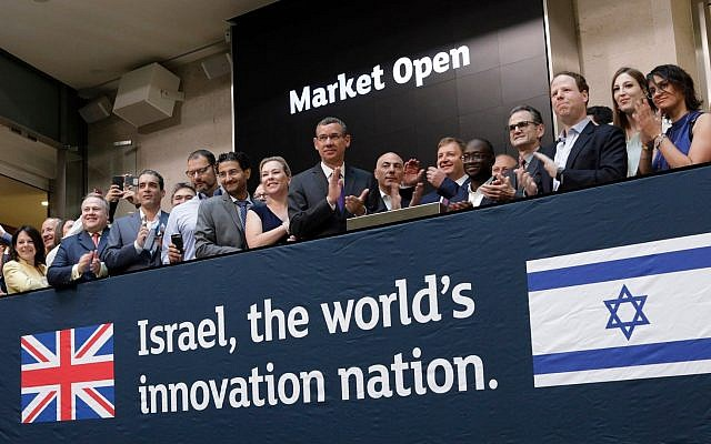 Israeli entrepreneurs and the UK Innovations Minister Sam Gyimah opens the London Stock Exchange on July 3, 2018, to celebrate growing links between Israeli tech and UK firms, organized by the UK Israel Business (UKIB).