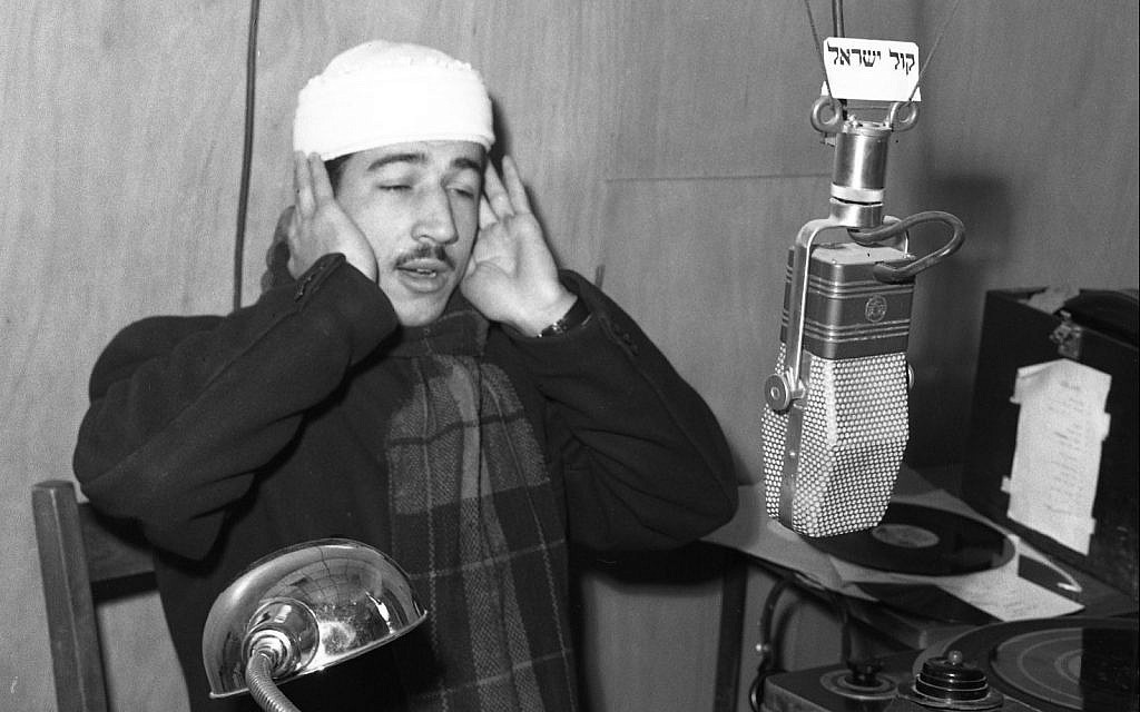On Israel Radio, a Muslim muezzin calling to prayer, early 1950s. (Efraim Ilani)