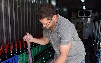 A student makes wine at Ariel University. (Courtesy)