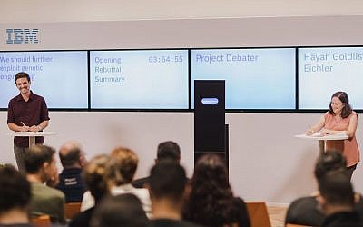 IBM's Project Debater, center, arguing for genetic engineering against professional debater Hayah Goldlist-Eichler (right) with Yaar Bach (left) moderating; July 3, 2018 (Or Kaplan)