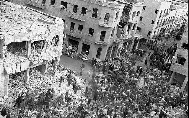 The scene of a car bombing on Jerusalem's Ben Yehuda street, February 22, 1948. Arab terrorists driving British army vehicles blew up, killing between 49 and 58 civilians, and injuring between 140 to 200. (Efraim Ilani)