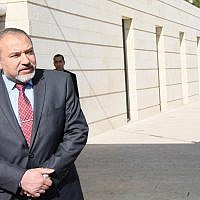In this file photo, then-foreign minister Avigdor Liberman waits outside the Ministry of Foreign Affairs in Jerusalem for a meeting with his Irish counterpart, Eamon Gilmore, Jan 29, 2012 (Kobi Gideon/Flash90)