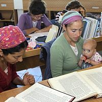 Illustrative: Jewish Orthodox women study Talmud at Kibbutz of Migdal Oz religious study seminary on May 23, 2013. (FLASH90 / Gershon Elinson)