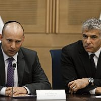 Yesh Atid chairman Yair Lapid (R) and Jewish Home head Naftali Bennett present an agreement reached between Israel's technological colleges and the Finance Ministry, at the Knesset, on October 27, 2013. (Flash 90)