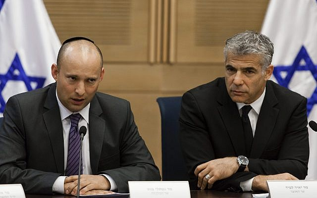Yesh Atid chairman Yair Lapid (R) and Jewish Home head Naftali Bennett present an agreement reached between Israel's technological colleges and the Finance Ministry, at the Knesset, on October 27, 2013. (Flash90)